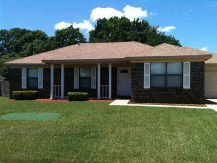 $124,900 Come home to this 3/2 home with a sparkling in-ground swimming pool.
