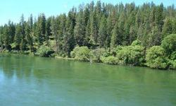 Build your dream home on this gorgeous 1.5 acre lot. There is even a building plan available! Look across the river to unobstructed views of Riverside State Park. The permits are in place for 125 lt set back. Perk tests have been completed and the septic