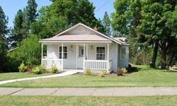 Quaint South Hill bungalow with new flooring, cabinets, counters, appliances, windows & more! Home features a great deck through the French doors off of the kitchen. A nice place to enjoy your morning coffee or a BBQ with friends. Shop is oversized and