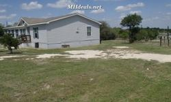 Standing at 2,304 square feet (32x 72) and standing on .73 acres, this 3 bedroom 2 bathroom double wide home is a great starter home for anyone. Resides minutes from town in a beautiful country setting. The interior comes with
