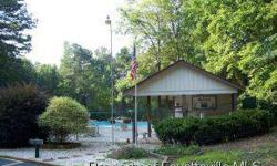 -Great level building lot at reduced price! Build now or later - builders available. Homeowners Association has pool and tennis.Listing originally posted at http