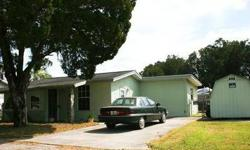 This 2 bedroom, 1 bath, 1 car garage home is located in Gulf Shores, a waterfront community in Hudson, Florida. The property is located on a cul-de-sac and has a fenced yard, 2 car garage, utility shed, along with dock/davits for Gulf access. The home has