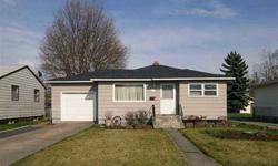 Nicely updated Mission Park home. Open Kitchen and Family Room. 3 main floor bedrooms and a Rec room with a bathroom in the basement. Low maintenance hardboard siding. 1 car attached garage plus a workshop in the backyard makes this 4 bed, 2 bath home