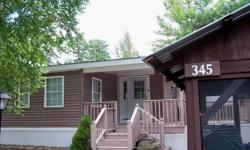 """PRICE IMPROVEMENT!! MOTIVATED Seller--may consider some owner financing. This is """"luxury camping"""" at it's best! Immaculately maintained, turn key Park Model with large, professionally built knotty pine addition. Turn key...just bring your tooth brush."""