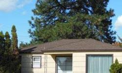 """Beautiful home in great Shadle area! Spacious living room with fireplace. Wonderful """"light & bright"""" kitchen with eating space. Hardwood floors under carpet on main floor. All appliances stay including washer & dryer in basement. Full basement with work"""