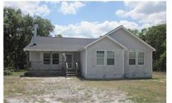 Forclosure, 3 bedroom modular home with great room floor plan and a fireplace. Wood cabinets, breakfast bar and dining area with sliding doors to the back yard. Over 1 1/4 acres fenced, plus nice oak trees and in a quiet residential neighborhood.