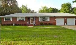 Nicely maintained family-owned home located on a full acre, surrounded by majestic landscaping in great location. Spacious family room features brick fireplace & leads to a screened-in patio, perfect for those cool summer evenings or entertaining guests.