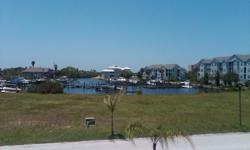 Gated oversized Deep water Canal front Homesite for sale
