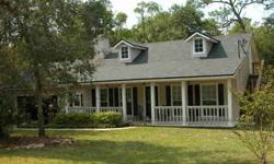 BACK ON MARKET! Beautiful Country Home on 2.32 acres. This charming plantation style home has magnificent tile floors, fireplace, a huge deck, gourmet kitchen and a fourth bedroom with private exterior access! The master suite has a glamorous jetted tub