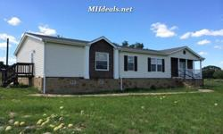 This beautiful 5 acres land and double wide home comes with 3 large bedrooms and 2 bathrooms. The surrounding land is a beautiful rural area that is easy to work with. The home comes with a gorgeous fireplace, rock-style kitchen with long island, large