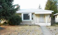 5 bed, 2 bath rancher close to shopping and quiet neighborhood. Wood floors. 2 family rooms with gas fireplaces. Fenced back yard. Alley access to shop.Listing originally posted at http