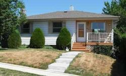 Located a little over 2 blocks from the regional hospital, this 3 bedroom/1bath home features updated oak cabinets in the kitchen,updated sink, B/I mircowave and dishwasher stay, slider to deck from dining room, hardwood floors under carpet in living