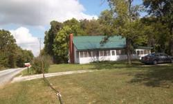 Beautiful spacious lawn, 2 acres of woodlot, cellar garden building, old barn and contents2 bedroom house , open living dining and kitchen with newer cabinets.Floors in Living rooms bedrooms and hall are hardwood. Bath and half bath,and mudroom have tile