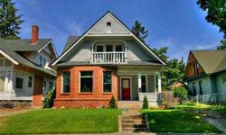Own a piece of history in this gorgeous, well-kept Turn of the Century Craftsman! This 4 bedroom, 2 bath home boasts the original woodworking, original interior doors with the original brass handles and interior locks! Full height basement with plenty of