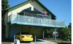 Short Sale: Watch the sunsets from the balcony with view of the gulf, this pool home is located on the canal and has a dock and a hot tub. Home has 2 bedrooms, 2 baths, 1 car garage and carport and parking for 4 cars. Home has newer kitchen cabinets a