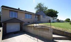 Home is in a desirable central location - Glenwood Park. Freshly painted exterior welcomes you to this property. Main floor of the home has been tastefully remodeled and a two sided fireplace adds to the ambience of the living room and dining room. Home