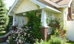 Adorable English cottage! This charming home has everything needed for a fairy tale life. 5 bedrooms, 2 baths, gas forced air heat with central air, a family room, fenced front and back yards, and an over sized 2 car shop! Everything is in wonderful