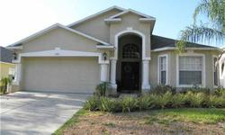 Short Sale - Wonderful 4 bedroom 3 bath Home in the gated community of The Verandahs. Open floor plan features expansive great room with separate dining room, volume ceilings and plant shelves galore. Split bedroom plan. The community features swimming