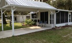 GREAT AND AFFORDABLE GET AWAY OR FULL TIME LIVING! CLEAN, TURN-KEY MOVE IN w/plenty of parking under a Gabled Carport Lot 61E www.HolidayTravelResort.com all age Park.Trailer has tub shower, oven, cook top, microwave, ac new flooring, new upholstery, new