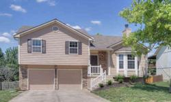 You won't have to worry about a thing when you move into this home! Five inch plank hardwood floors, new carpet, granite countertops, light fixtures, exterior paint, landscaping, garage doors and openers - the list goes on! There is a great bonus room in