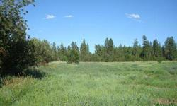 Incredible location! This beautiful, close in 17 acres offers an attractive mix of treed areas and open meadows ablaze with colorful wildflowers. A natural spring on the north end of the property supports a seasonal creek. Feel like youre out in the