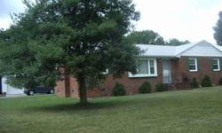 All Brick Ranch! Oversized Detached GARAGE w/8' Door! Shows Well! Wood Floors throughout except for Kitchen,Baths and Laundry Room! Pocket Door from Living Room to Family Room and from Kitchen to Laundry Room!NEW UPGRADED WINDOWS in 2010! NEW LENNOX HEAT