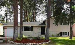 This charming four bedroom home has easy care tile floors in the kitchen and informal dinning area. Open floor plan with a wood burning stove for the next winter snowy days. Covered deck, nicely landscaped and completed fence back yard. More pictures
