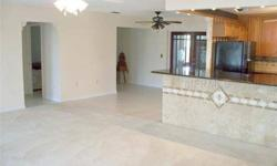 Look at this Bahamian Model with 2 bedrooms, a den, 2 baths and a 2 car garage with a side entrance for your golf cart. The kitchen in this home has been updated with oak cabinets, granite countertops and a huge island. Kitchen aid dishwasher and range
