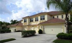 GREAT FIND! Really nice first floor coach home with LAKE VIEW. This 2 bedroom plus den, 2 bath condo offers a 2-car attached garage. Ceramic tile and carpet throughout. Located close to Downtown Naples, this property is in Madison Park which offers bike a