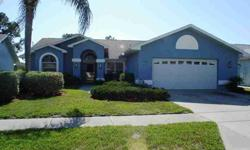Beautiful, spacious pool home shows pride of ownership. 28x14 pool with spa in high bird cage with covered entertainment area with sink. Lots of cathedral ceilings and sliding doors make this home bright and airy. Lovely tile and laminate floors plus