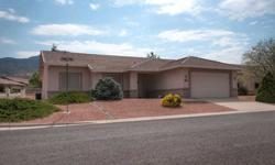 on oversized corner lot with views of Mingus Mountain and far away views of Sedona's red rocks. The Cottonwood Ranch area boasts 500+ well maintained homes with walking paths, playground, bocce courts, and community pool all situated near National Forest