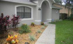 Lovely holiday builder Sheridan Model 3/2 pool home. Vaulted ceilings with plant shelves and recessed lighting thru out. New laminate flooring that looks like hardwood in great room. Lovely light and bright kitchen with stainless steel appliances,