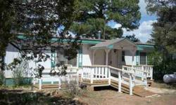 This three bedrooms/two bathrooms manufactured home has a nice floorplan with two master suites and family room/den with woodstove for winter enjoyment. Diane Dahlin is showing 3092 Chevelon Rd in OVERGAARD, AZ which has 3 bedrooms / 2 bathroom and is