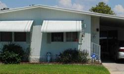This is a 1983 doublewide for $17000 with 2/2 and the 1200 SqFt. is a rough estimate. It comes with a carport, washer, dryer, Florida room, laundry room, tile and carpet floors, and overall a very nice home It's only a 40+ community, has pool access, and