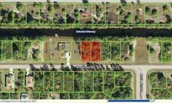 Waterfront lot with Gulf Access via South Gulf Cove lock system. The bridge on 771 is approximately 6 foot high, the other bridges to go under are about 10 feet high. The lot next door is also available for sale at $17,500. Rotonda Lakes is a deed