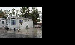 Cute 1/1 Furnished Mobile Home for Sale in Naples Florida! Home sits on a lot that has a 99 year land lease. Mobile Home has an attached screened lanai, Washer & Dryer and Carport. Located in Panthers Walk RV Resort. Resort features WiFi, Pool and