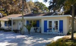 Key West Style! Clean & Comfortable 2 Bed/2 Bath Lakefront Home Features Granite Countertops, Stainless Appliance Package, Jacuzzi Tub, Fresh Coat of Paint(Inside and Out), 2 HVAC Systems, and a Natural Stone Wood Burning Fireplace. The 3 Spacious Wooded
