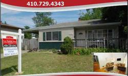 Large 3 bedroom, 1 full bath split level on spacious lot! Features include vaulted ceilings in the living room, hardwood floors throughout the living and formal dining room, spacious kitchen with ceramic tile and stainless steel appliances, full basement