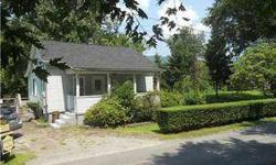 FAYETTE COUNTY- A river-side vacation home near Kanawha Falls/Glen Ferris. Or live there year-round! Situated on 3 acres with river frontage and a dock. Large deck spanning the back giving views of the water. Main floor br & Upper level BR could be made