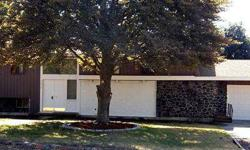 Rock Solid 1960's Custom Across from Golf Course! Sprawling Floor Plan with nearly 3000 Sq Ft! Remodeled Kitchen with New Range, New Dishwasher and Tile Countertops. Beautiful New Flooring Throughout. Large Master Bedroom with 3/4 bath. Light and Bright