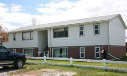Apartment complex with 4 two bedroom 1 bath apartments.