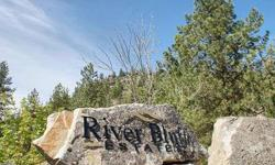 Beautiful level piece of property ready for your dream home. This stunning 10 acre parcel has well already installed. The dramatic rock cliffs rising out of the eastern side of the property provide both privacy and the opportunity for a landscape