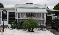 This is a very nice 1974 singlewide home with 2 bedrooms 1 bathroom and 854 Sq. Ft. A clean and bright home that comes fully furnished, with a carport, shed, Florida room, 1 year old roof, and Beautiful landscaping. Pets are ok, comes with pool access and