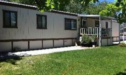 MOBILE HOME FOR SALE-$19,500 In Carson City 1987 Kit 14'x67' 2 bedrooms and 2 full baths on opposite ends of mobile. Laundry room with washer and dryer included. Cathedral ceilings. Bright kitchen with dishwasher and refrigerator included. Newly painted