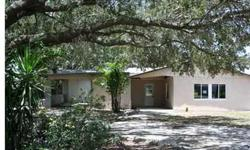 Affordable with incredible possibilities ... large tropical lot, in-town location ... 2 bedroom 2 bath home, but with the feel of a much larger home. This is a Fannie Mae HomePath property.
