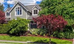 Updated to perfection, this stunning two-story sets the stage for impressive entertaining both indoors & out. The masterful kitchen is the heart of the home featuring brilliant cherry cabinets topped with striking slab granite. The casual dining area