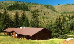 On the banks of the Snake River is a private oasis. A three-bedroom log home punctuated by tiered landscaping and gardens features a fabulously remodeled kitchen, cozy living room and hearth room, oversized covered porches & outbuildings to accommodate