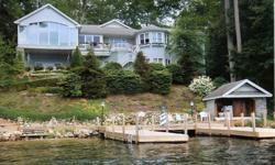 This home is an absolute masterpiece combining an inspired modern open design flooded with natural light, with impeccable finishing details.Overlooking 150? of perfect shore, offering sandy beach, U-shaped crib dock for 3 boats and a lakeside cabana with