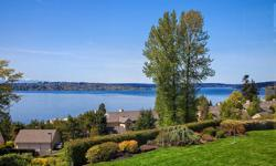 Enjoy majestic sunsets & exceptional lake/mountain views from nearly every room of this custom built northwest contemporary home. Stunning architecture adds character & charm while maintaining functionality. High ceilings & expansive windows maximize the