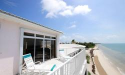 Magnificent One of a Kind Ocean View Beachfront Home with all the benefits of a single family home without the worry of maintenance. This luxury condo has open ocean views from 3 levels, large pool, private deeded dock located on protected canal and